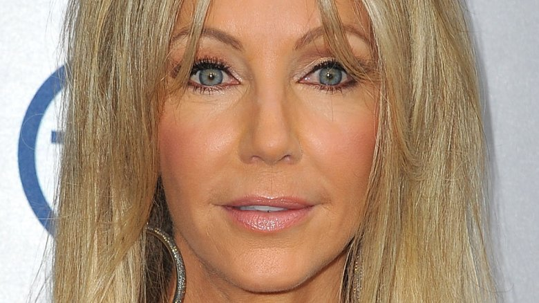 Heather Locklear shows flowers, not injuries, after driving into ditch