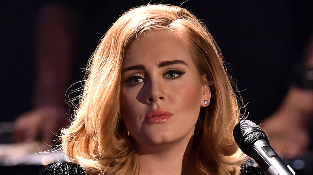 Adele reaches divorce settlement two years after split from Simon Konecki