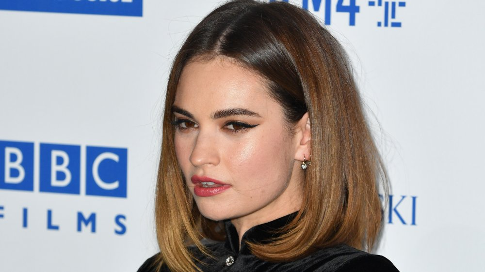 After kissing Dominic West, Lily James cancels her appearance