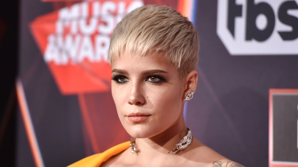 Halsey with a serious expression