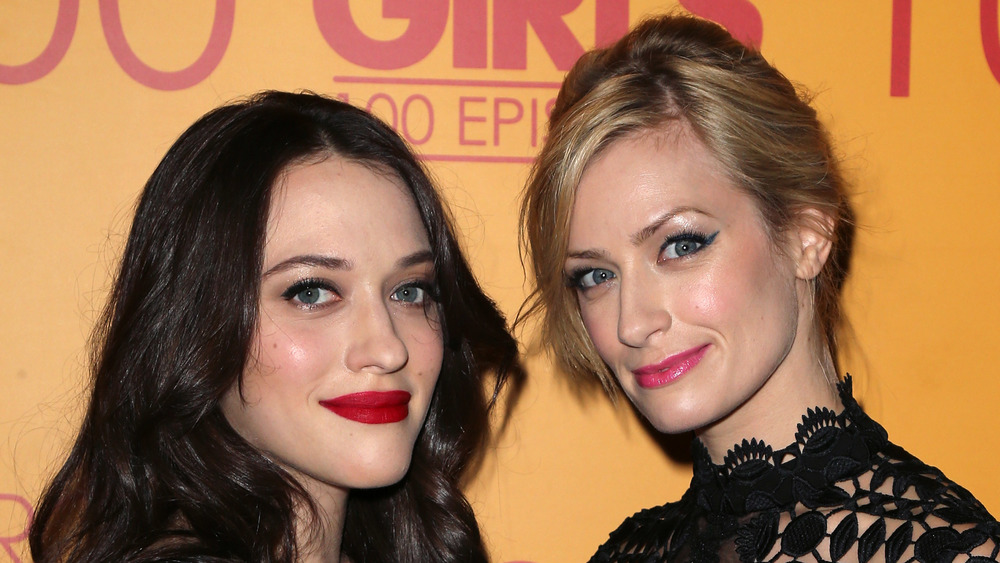 Kat Dennings and Beth Behrs on a red carpet