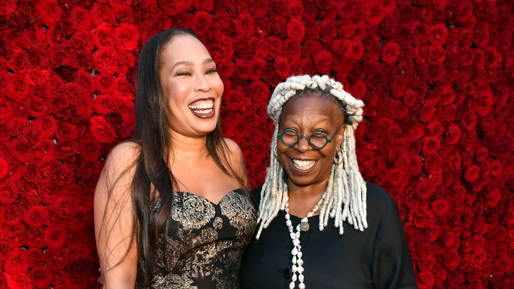 Whoopi Goldberg and daughter Alex Martin pose on a red carpet
