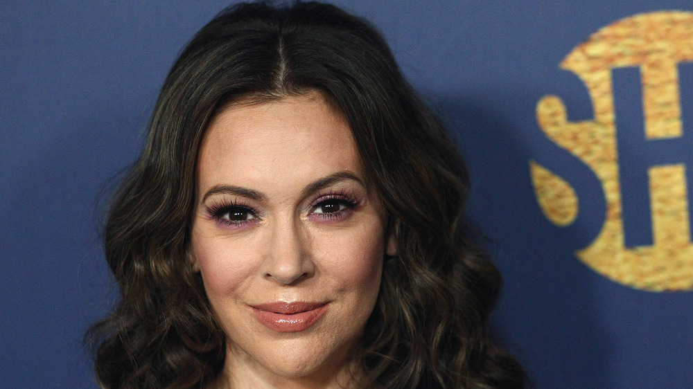 Alyssa Milano smiles for a photo on the red carpet