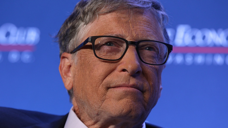 Bill Gates wearing black-rimmed glasses