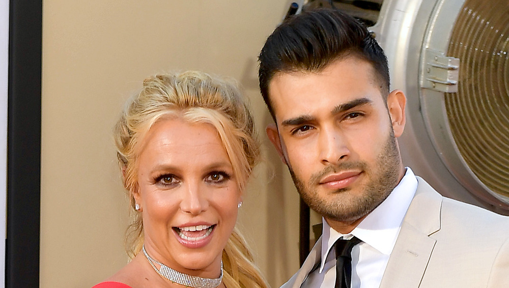 Britney Spears and Sam Asghari pose together at an event