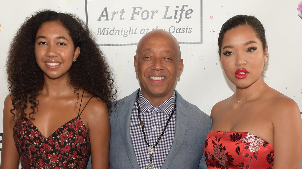 Russell Simmons with his daughters, Ming and Aoki