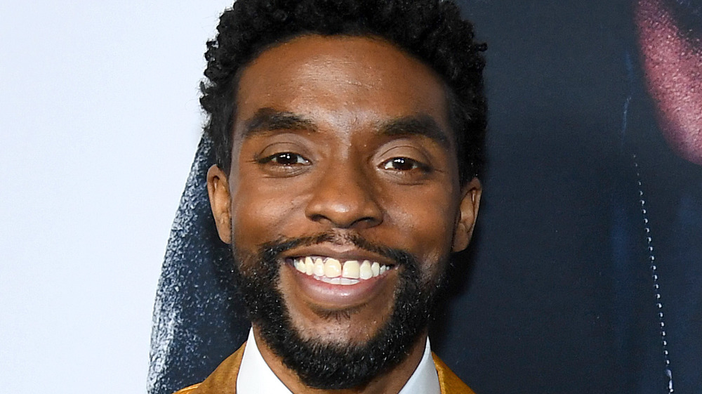 Chadwick Boseman smiling wide for cameras