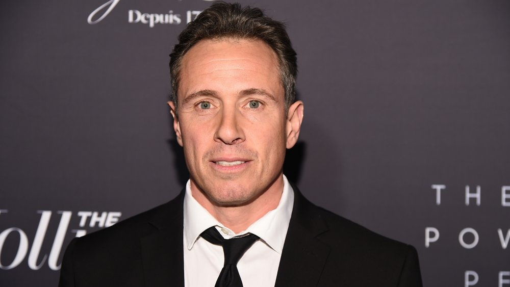 Chris Cuomo in black suite and white shirt