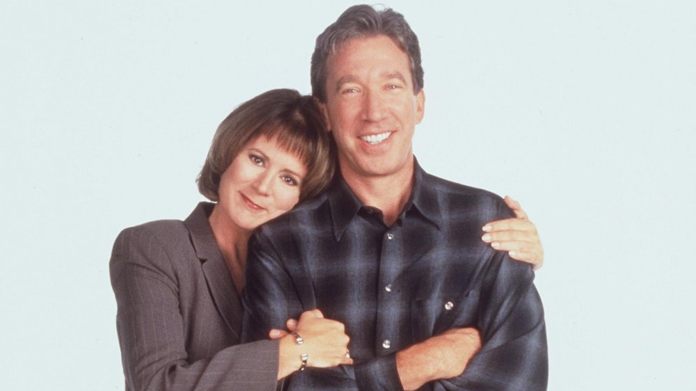 Patricia Richardson and Tim Allen posing for a Home Improvement promo shot