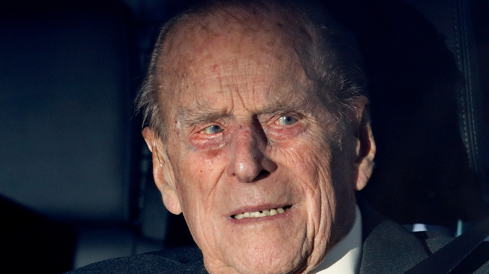 Prince Philip sitting in a car