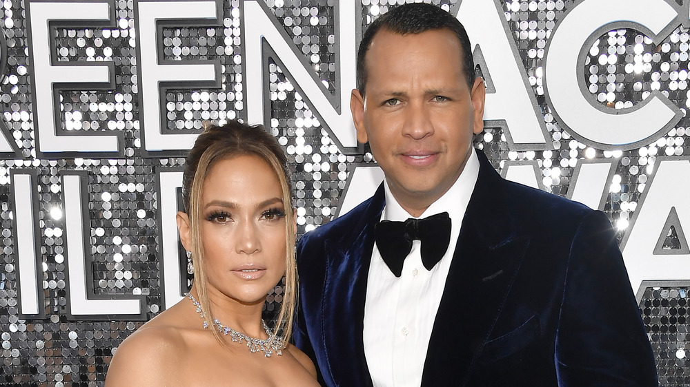 Jennifer Lopez and Alex Rodriguez posing on red carpet