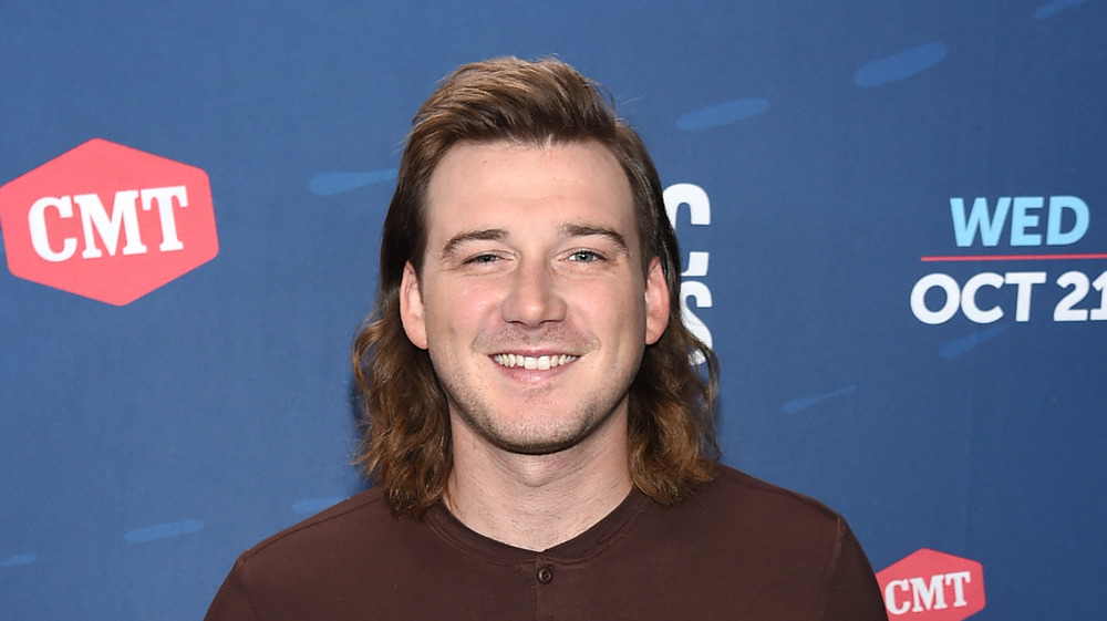 Morgan Wallen smiling on the red carpet