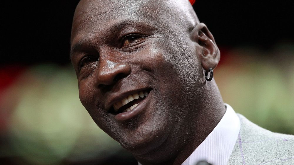 Michael Jordan smiling while tilting his head to the side