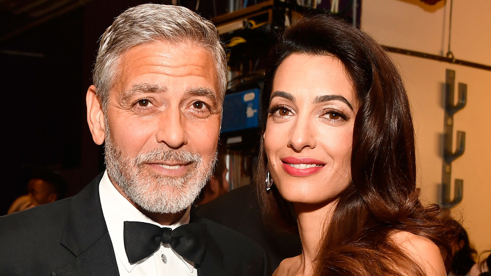 George and Amal Clooney at an award show