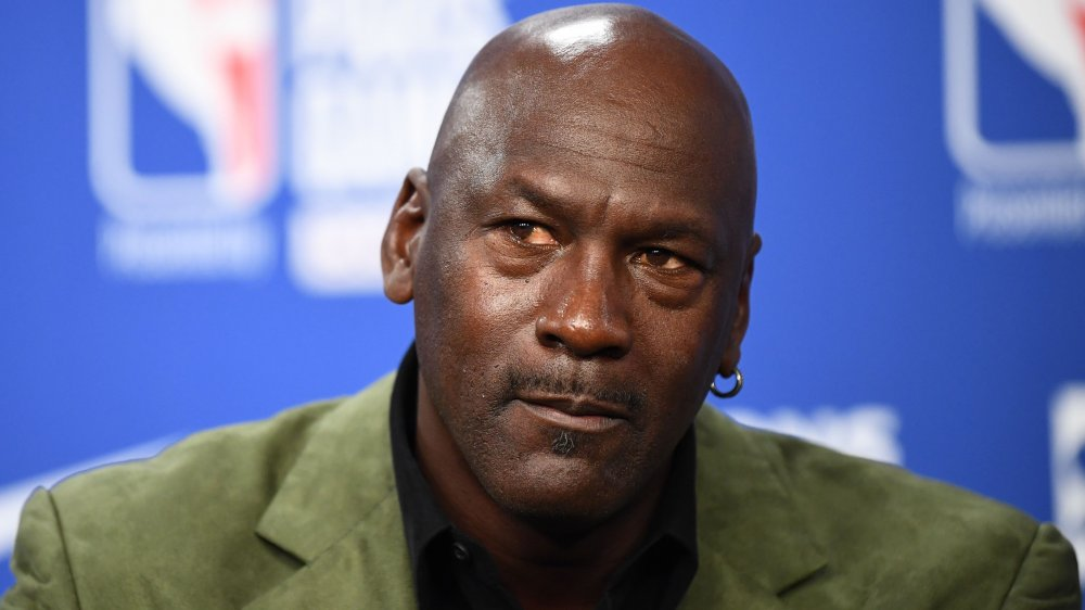 Michael Jordan of the Chicago Bulls listens to a question addressed to him about his future 11 June during a press conference after practice for Game Five of the NBA Finals
