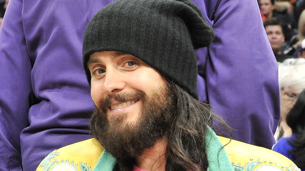 Jared Leto sitting court side