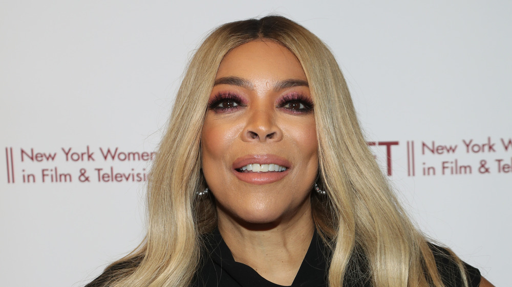 Wendy Williams smirks as she poses for a photo on the red carpet