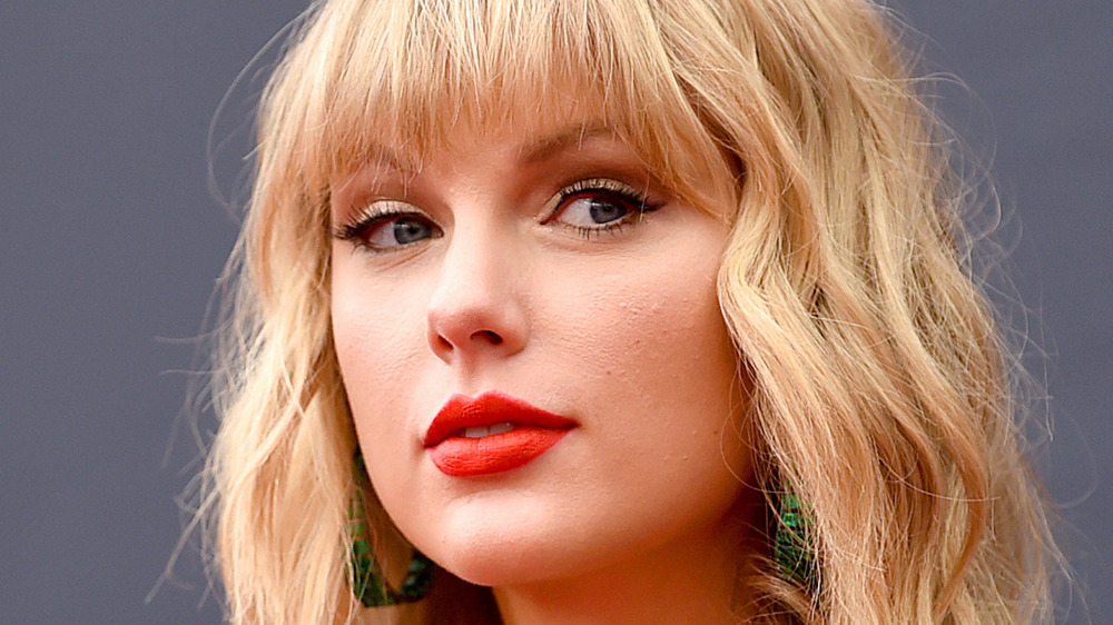 Taylor Swift with a confident expression