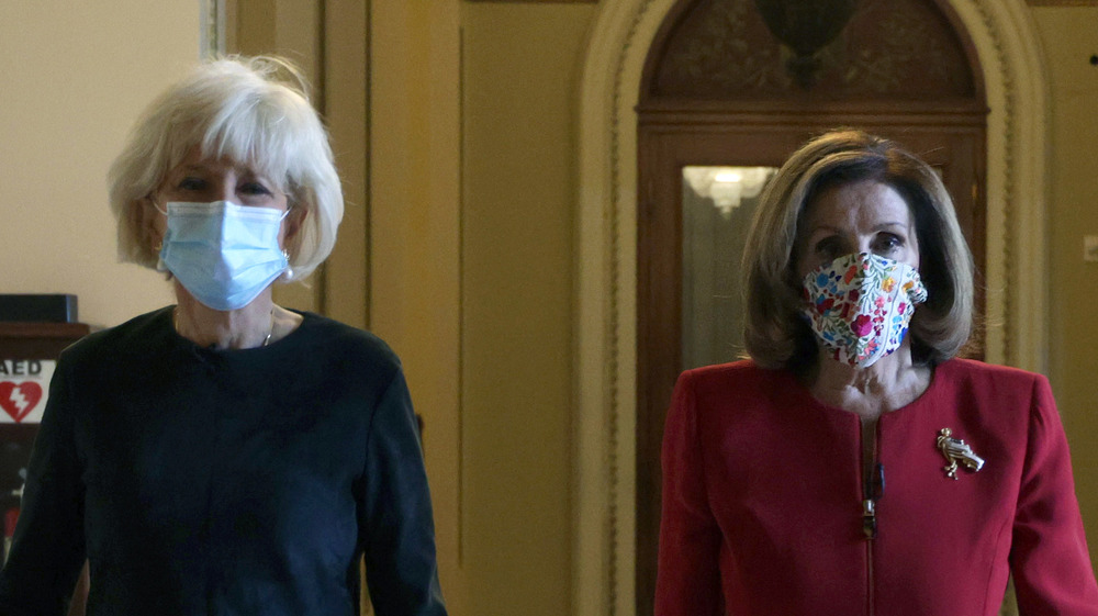 Lesley Stahl and Nancy Pelosi walking together