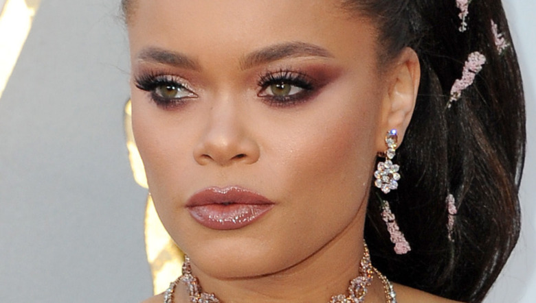 Andra Day looking to the side while posing on the red carpet