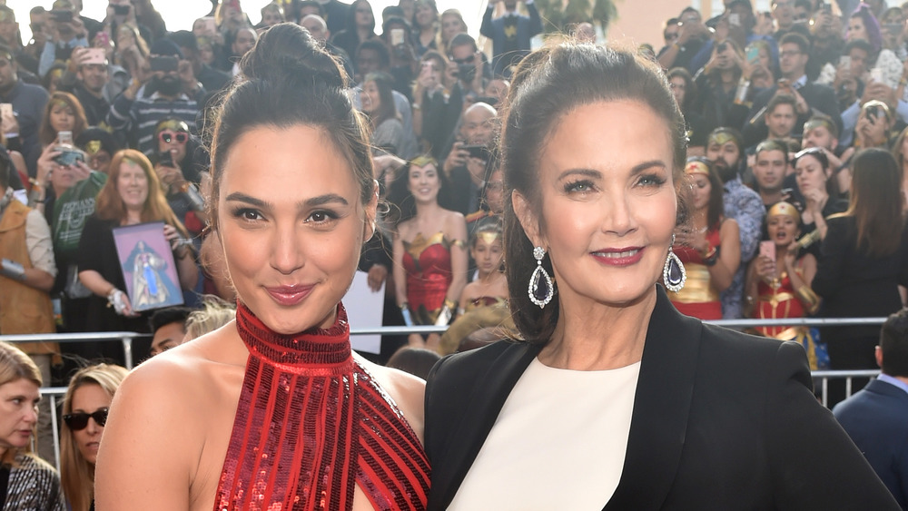 Gal Gadot and Lynda Carter smile for cameras next to each other