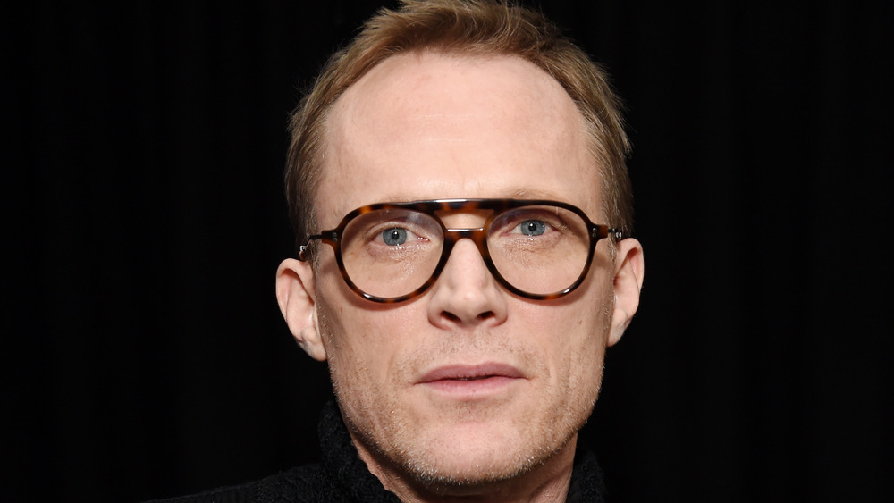 Paul Bettany wearing glasses looking directly forward