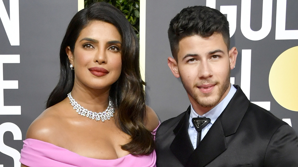 Priyanka Chopra and Nick Jonas posing together on the red carpet