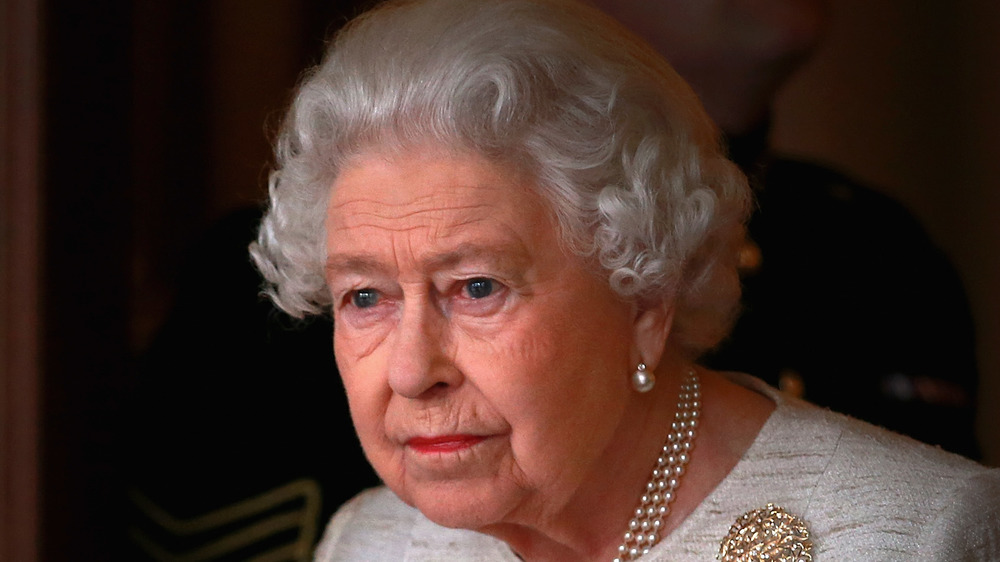 Queen Elizabeth looking upset