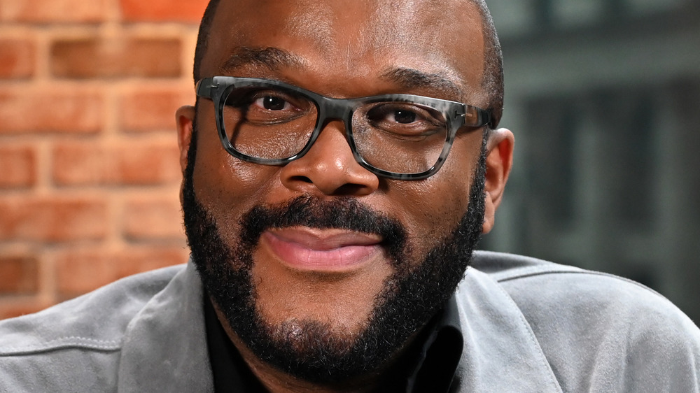 Tyler Perry wearing glasses during an interview