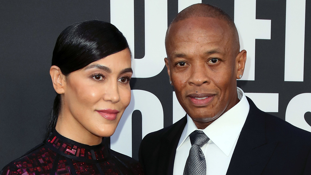 Nicole Young and Dr. Dre posing on the red carpet