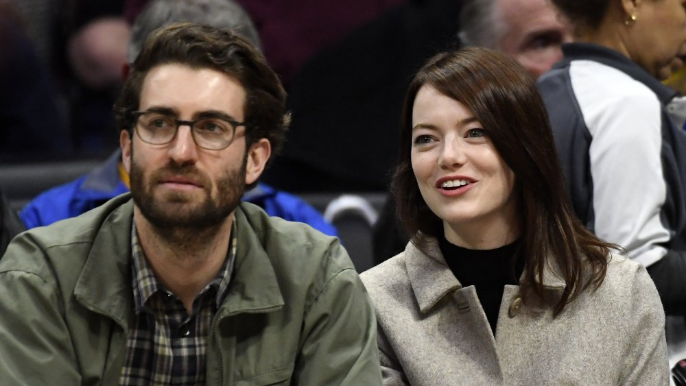 Dave McCary and Emma Stone at a basketball game
