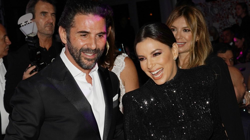 Jose Baston in a suit and Eva Longoria in a sequinned dress together
