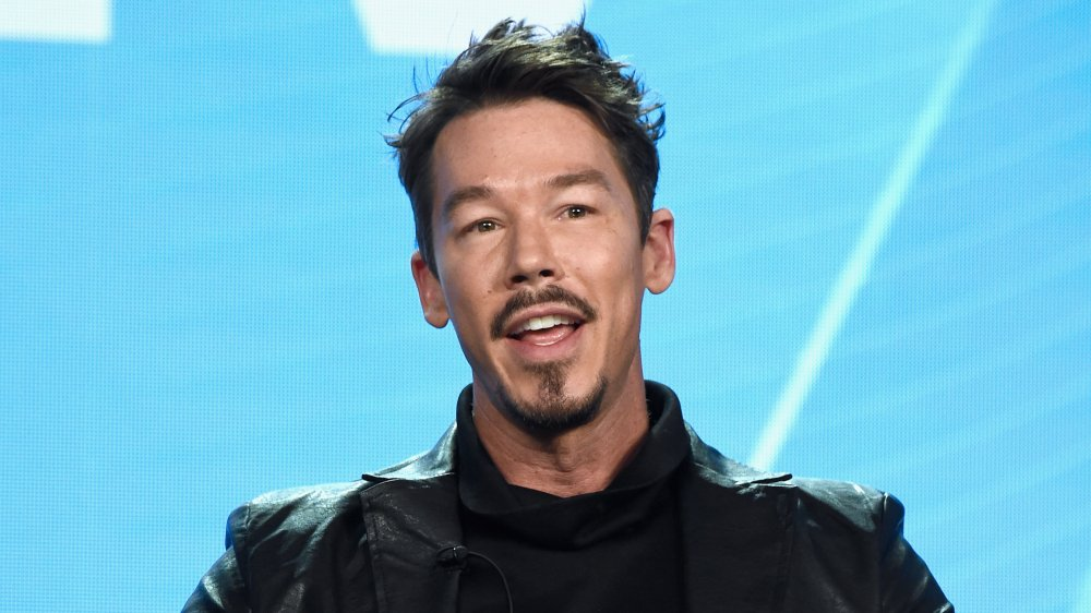 David Bromstad speaking at a panel event