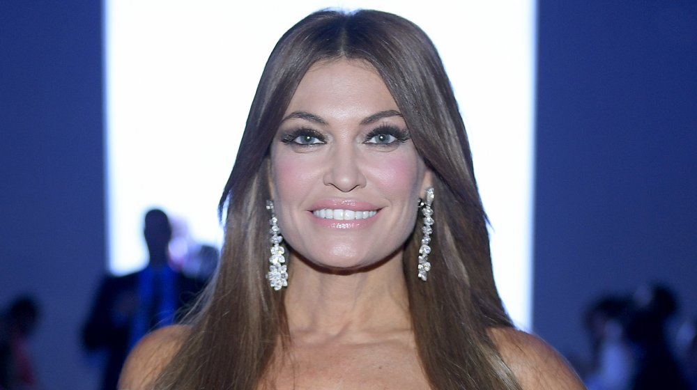 Kimberly Guilfoyle in a blue dress and red lipstick