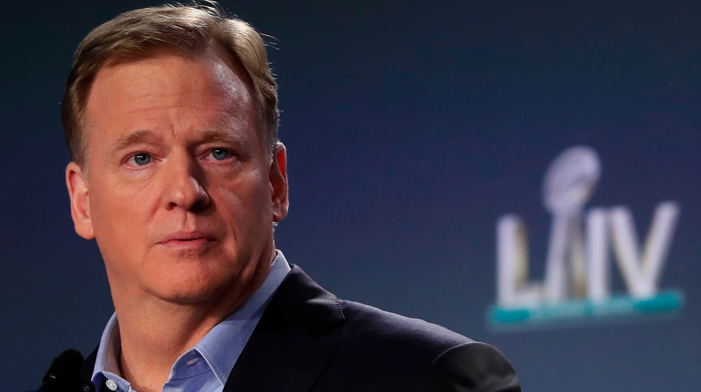 Roger Goodell looking serious at a press conference