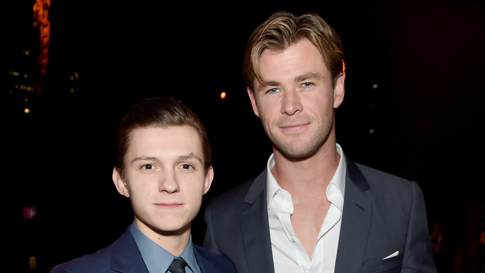 Tom Holland and Chris Hemsworth Posing for a picture