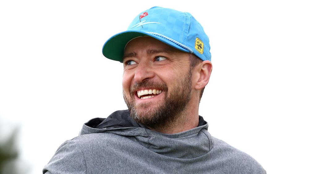 Justin Timberlake playing a round of golf