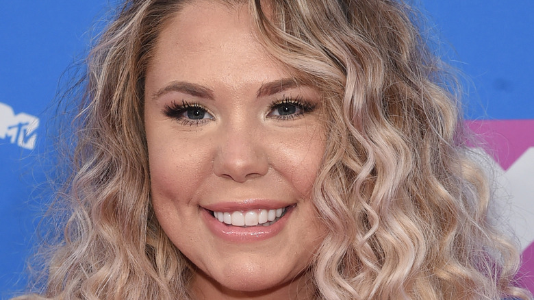 Kailyn Lowry in curly hair smiling