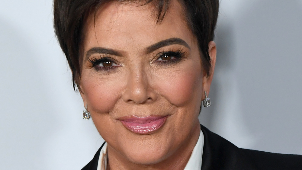 Kris Jenner smiling for the cameras at an event