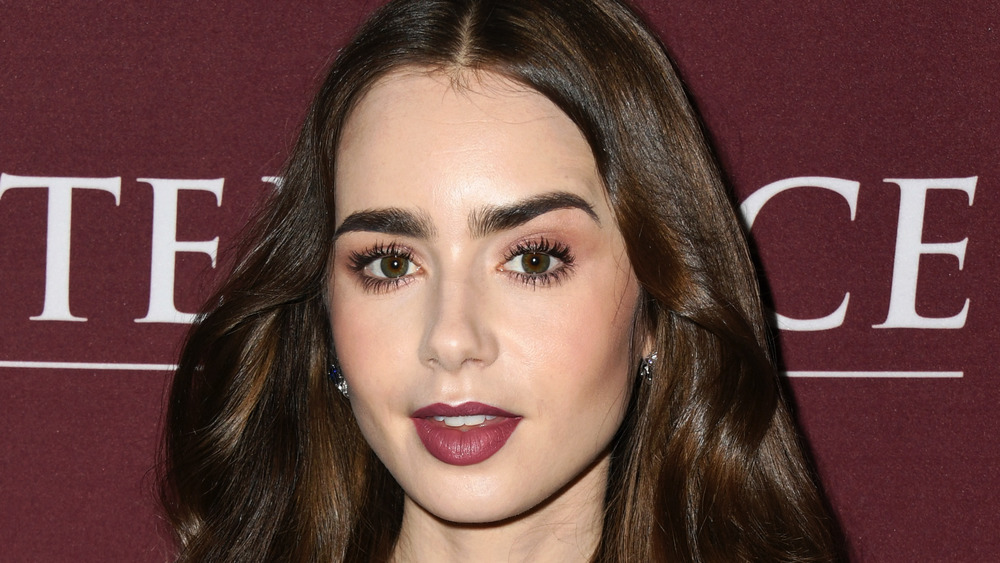 Lily Collins with a slightly surprised expression