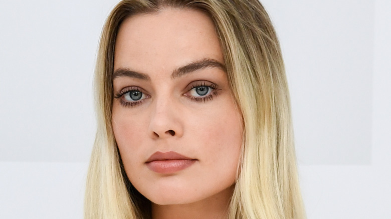 Margot Robbie poses at an event