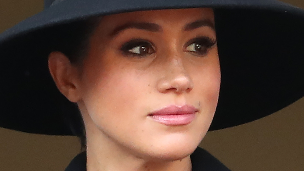 Meghan Markle wearing a hat at an event