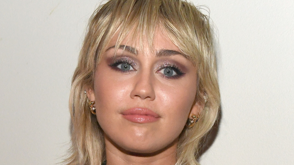 Miley Cyrus with a neutral expression
