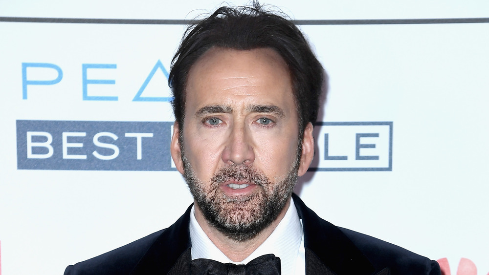 Nicolas Cage wearing a tuxedo on the red carpet
