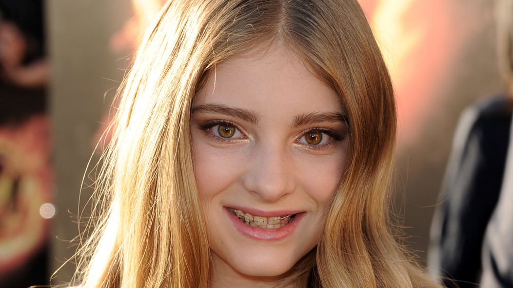 Willow Shields smiling on a red carpet