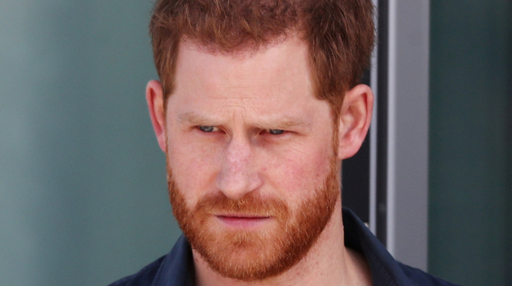Prince Harry stares off into the distance