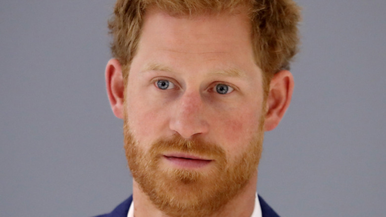 Prince Harry stares into the camera