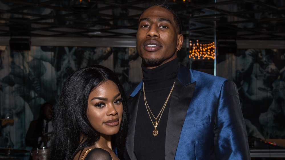 Teyana Taylor and Iman Shumpert, posing arm in arm