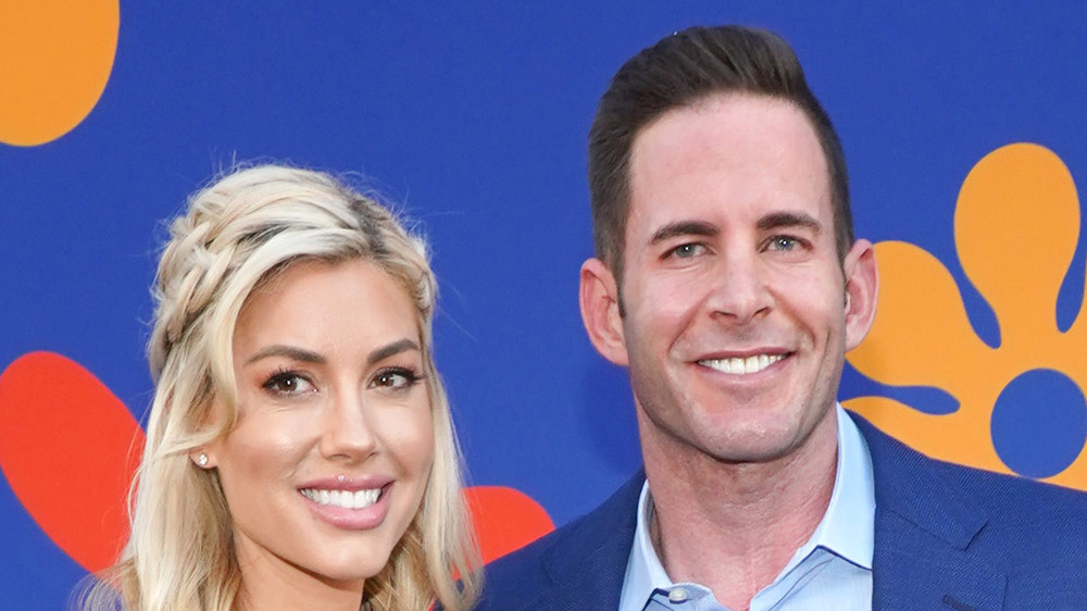 Tarek El Moussa and Heather Rae Young at an event