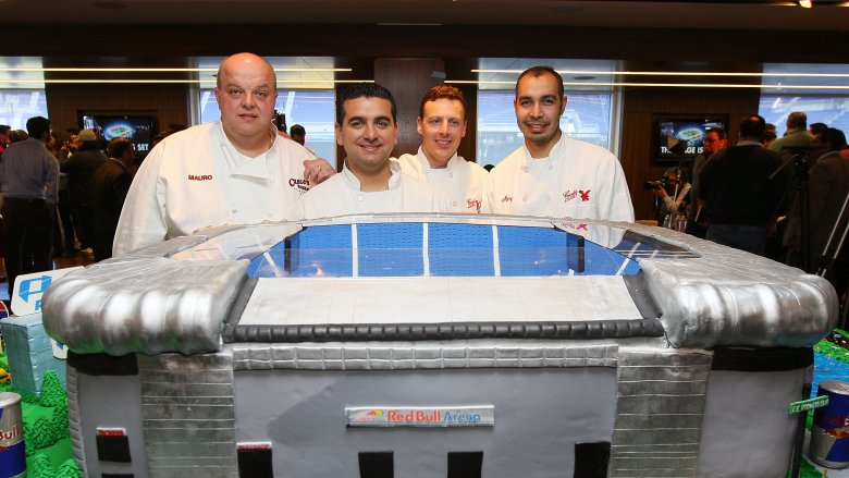 The Cake Boss cast with Remy Gonzalez (right)
